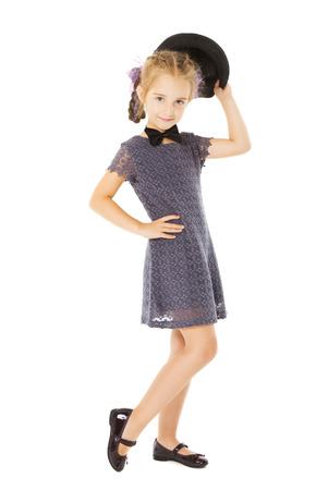 formal wear clothing: little girl portrait, kid well dressed in formal wear children dress, isolated on white background  Stock Photo