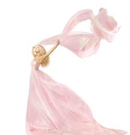 lleno: Mujer Vestido Moda Belleza, Chica Vestido de seda En ondeando en el viento de la tela, modelo con larga Flying Aleteo Tela, aislados sobre fondo blanco Foto de archivo