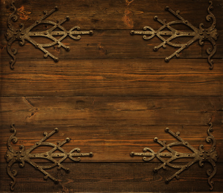 forged: Christmas Wooden Background Decorated By Grunge Ornament, Metal Design Border Elements, Vintage Wood Grain Board Texture Stock Photo