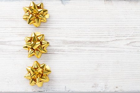Christmas Wooden Background, Bow Golden Stars Decoration , White Wood Board, Xmas Decorative Holiday Texture photo