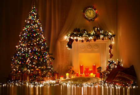 Christmas Room Interior Design, Xmas Tree Decorated By Lights Presents Gifts Toys, Candles And Garland Lighting Indoors Fireplace Stock Photo