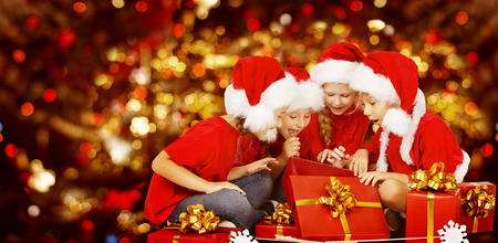 Christmas Kids Opening Present Gift Box Happy Children In Santa Hat Smiling Boys And