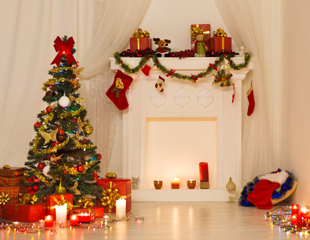 Christmas Room Interior Design, Xmas Tree Decorated By Lights Presents Gifts Toys, Fireplace and Candles Lighting Indoors photo