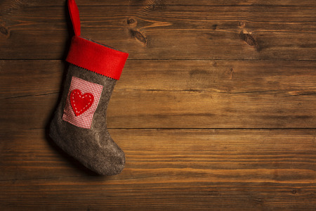 Christmas Stocking, Sock Hanging Over Grunge Wooden Background, Brown Wood Wall Xmas Decorative  Texture photo