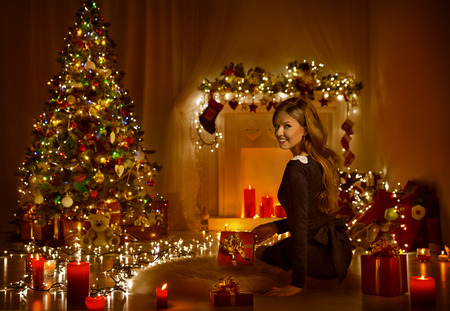 Christmas Woman Open Present Gift Box In Xmas Room, Holiday Tree Illuminated With Candles Lights