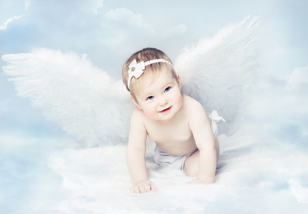 newborns: Baby Angel with Wings, Newborn Kid at Blue Sky Cloud. Artistic Fantasy Background Stock Photo