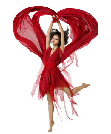 Woman Dancing With Heart Shaped Fabric Cloth, Beautiful Girl in Red Dress Waving On Wind. Isolated Over White Background photo