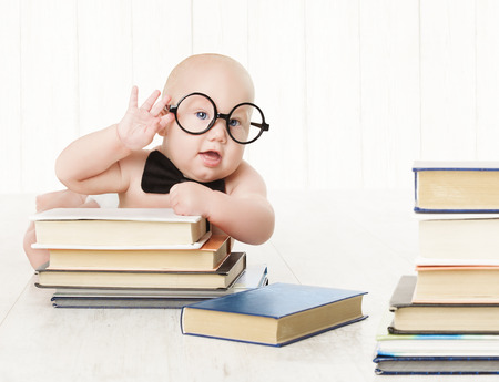 early childhood: Baby in Glasses and Books, Kids Early Childhood Education and Development, Smart Child Preschool Reading Concept, over White Background