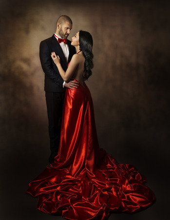 Couple in Love, Lovers Woman and Man, Glamour Classic Suit and Dress with Long Tail, Fashion Beauty Portrait of Young Models, Well Dressed in Valentine Day