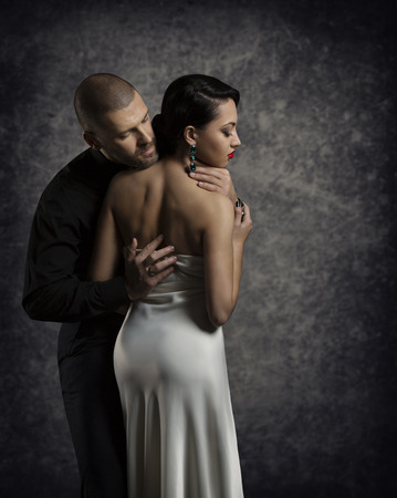 sexy woman nude: Couple Portrait, Man Woman in Love, Boy in Dark Embracing Elegant Sexy Girl in Gown with Naked Back Stock Photo