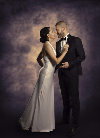 evening gown: Couple Retro Man and Woman in Love, Fashion Beauty Portrait of Models Embracing over Vintage Background