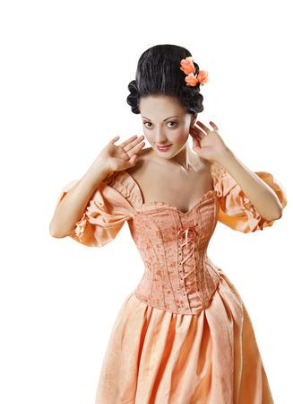 vestidos de epoca: Mujer en el barroco histórico Traje del corsé, Chica en vestido rococó del estilo retro Flirtear aisladas sobre el fondo blanco Foto de archivo