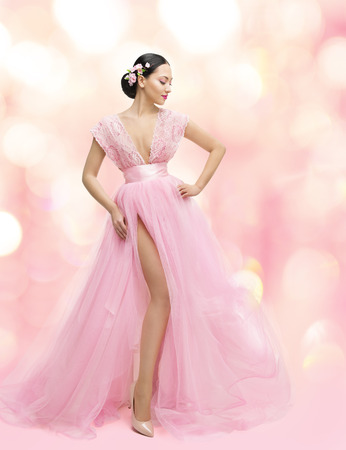 gown: Woman Beauty Portrait in Pink Dress with Sakura Flower, Asian Girl Fashion Gown, Beautiful Model over Unfocused Background Stock Photo