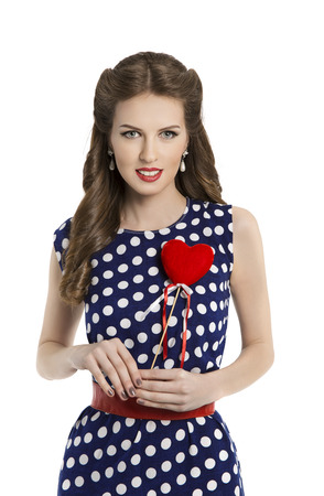 make over: Woman in Polka Dot Dress with Heart, Retro Girl Pin Up Hair Style, Beauty Make Up and Hairstyle, Isolated Over White Background