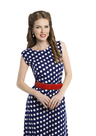 Woman in Polka Dot Dress, Retro Girl Pin Up Hair Style, Beauty Make Up and Hairstyle, Isolated Over White Background photo