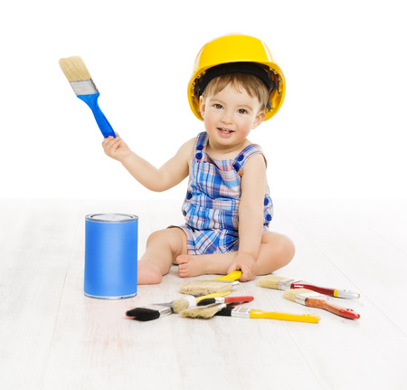 designer baby: Baby Painting Brush Color. Child Boy Funny Little Designer, Small Kid Play in Hard Hat, Early Profession Concept, Isolated over White Background