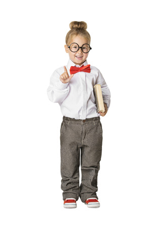 smart boy: School Child Portrait, Little School Girl in Glasses with Book, Kid Finger Point Up, Small Student Isolated Over White Background, Early Education Concept Stock Photo