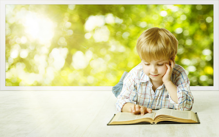 open windows: Young Child Boy Reading Book, Children Early Development, Small Kid School Education, Study and Knowledge Concept Stock Photo