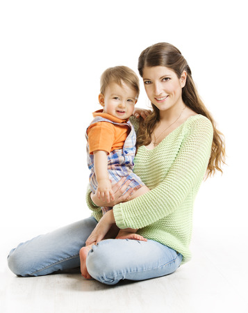 sitting small: Mother and Son Little Kid Family Portrait, Young Woman with Small Child on Hands, Isolated over White Background, Looking at Camera