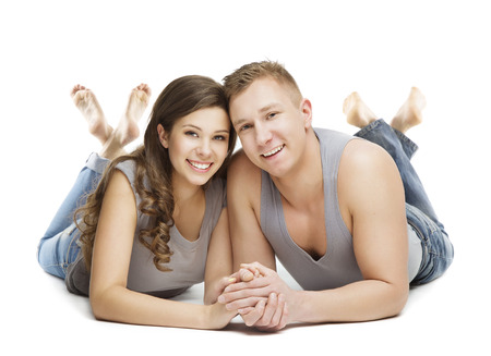 young couple smiling: Young Couple Portrait, Happy Girl and Boy Friend Hold Hand in Hands, Woman and Man Isolated over White Background
