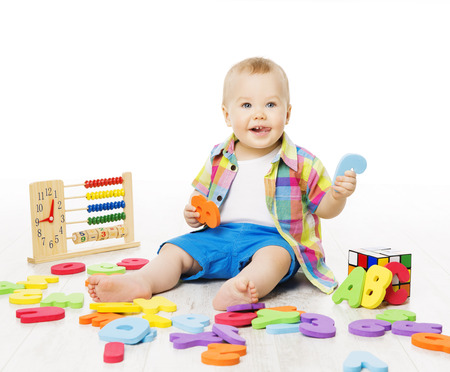 Baby Playing Education Toys, Kid Play Alphabet Letters Numbers Logic Toy, Little Child Early Development Concept photo