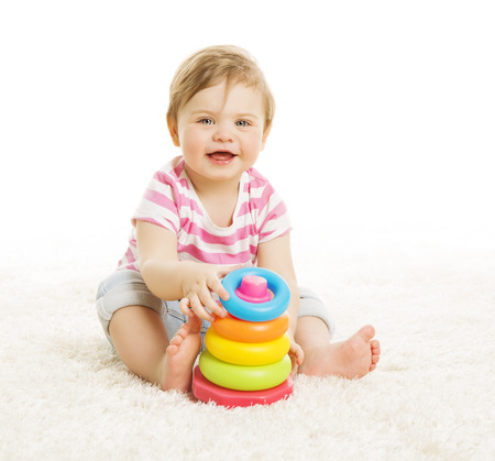 Baby Playing Toys, Child Play Pyramid Tower, Little Kid Early Education Concept, isolated over white background photo