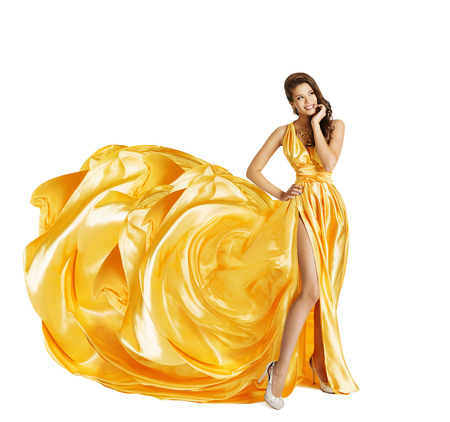 Woman in Yellow Art Silk Dress, Surprised Girl Looking Sideways, Gown Cloth Fabric as Flower, Beauty Model Isolated over White Banco de Imagens