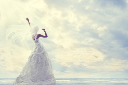 wind dress: Honeymoon Trip, Bride in Wedding Dress over Blue Sky, Romantic Travel Concept, Looking Ahead