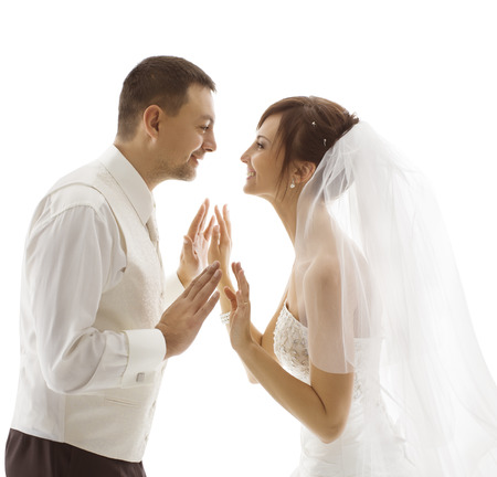 Bride and Groom Portrait, Wedding Couple Looking Each Other, Happy Face over White Background photo