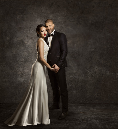 gown: Wedding Couple, Bride and Groom Fashion Portrait, Elegant Suit, Long Silk Dress, Full Length Stock Photo