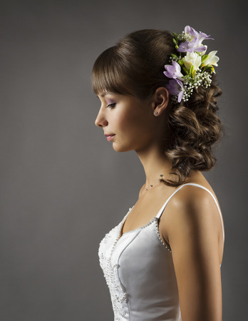 bridal hair: Bride Portrait, Wedding Hairstyle with Flowers, Bridal Hair Style over gray background