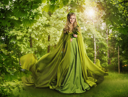 Fantasy Fairy Tale Forest, Fairytale Nature Goddess, Nymph Woman in Mysterious Green Dress 스톡 콘텐츠