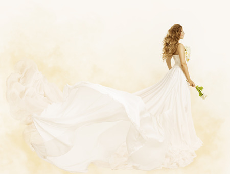 Long Dress, Woman Beauty Yellow Gown with Flower, Fashion Festive Clothes Archivio Fotografico