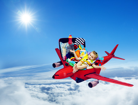 Airplane Travel, Baby Kid Packed Suitcase, Child Flying inside Luggage Plane to Holiday Vacation over Blue Sky
