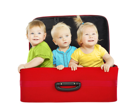 Children in Travel Case, Three Kids Travelers inside Suitcase, Toddlers Playing Passengers photo