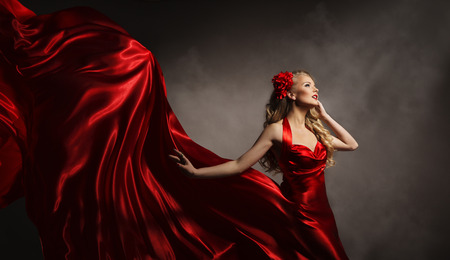 side pose: Model in Red Dress, Glamour Woman Posing in Flying Long Silk Cloth on Wind, Beauty Fashion Portrait