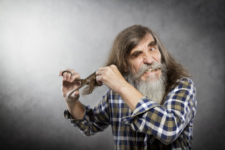 Old Man Scissors Cutting Hair Senior with Crazy Face Self Trim Long Hair