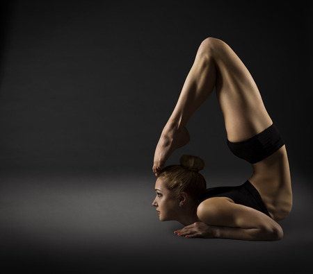 female gymnast: Back Bending, Woman Bowing Stretch Arch, Gymnastics Acrobat in Backbend Exercising Pose