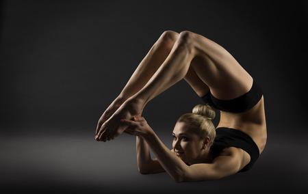 acrobatics: Back Bend Stretching Posture, Bending Woman Acrobat Gymnastics, Sporty Yoga Girl Fitness Training Stock Photo