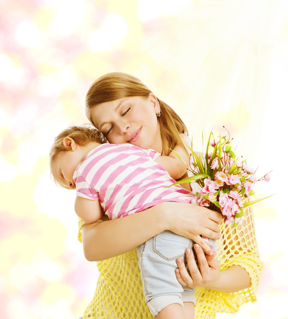 congratulate: Mother and Baby Family Portrait with Flowers, Little Kid Embracing Mom, Child Congratulate Mothers Dat and Love Concept