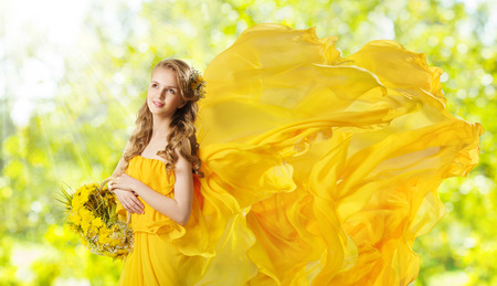 Young Girl with Yellow Flowers Dandelion Basket, Fashion Model Posing with Flying Fabric