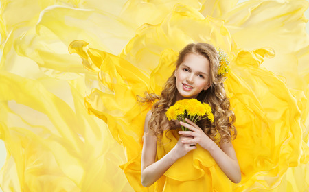 Woman and Yellow Flowers Bouquet, Young Model Makeup Portrait and Dandelion, Flying Fabric photo
