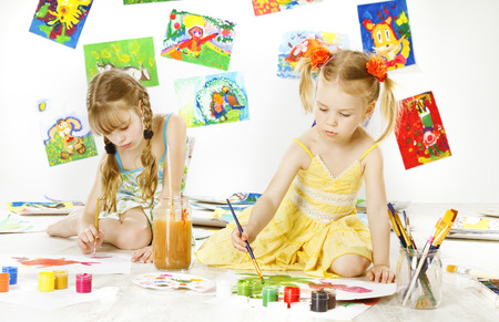 Creative Kids Painting by Brush, Little Girls Drawing Image, Children Inspiration Education Concept Stock Photo