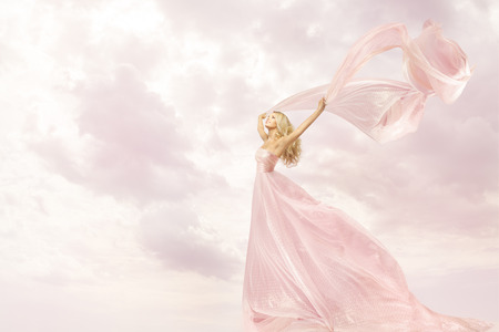 Happy Woman in Pink Long Dress, Girl with Flying Silk Scarf Cloth, Joy Open Arms Freedom concept