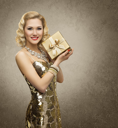 Rich Woman with Gift Box, Luxury Retro Girl in Shining Gold Dress, Yellow Golden Present for VIP Lady