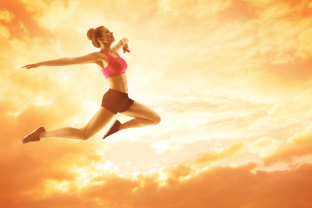 summer sport: Sport Woman Running, Athlete Girl in Jump, Happy Fitness Concept, Jumping and Flying Sunny Sky