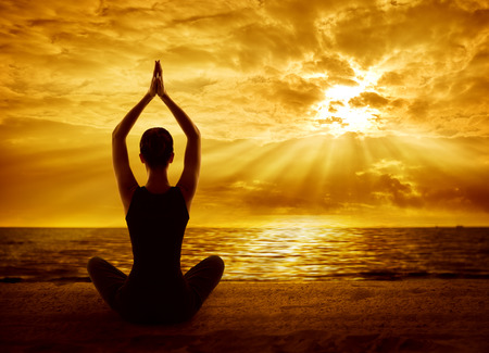 Yoga Meditation Concept, Woman Silhouette Meditating in Healthy Pose, Back View on Sun Light Rays
