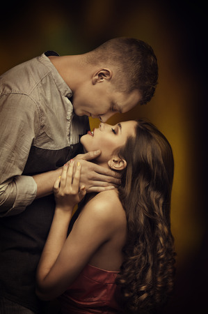 young couple hugging kissing: Young Couple Kissing in Love, Woman Man Romantic Passion Desire, Intimate Emotions of Lovers