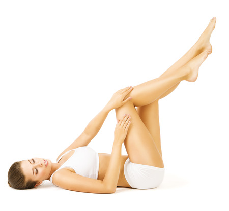 Woman Body Beauty, Lying Girl Touch Legs Skin, White Cotton Underwear. Stock Photo