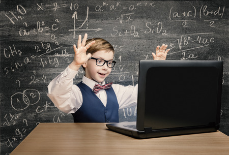 Kid Looking at Laptop, Child with Notebook, Little Boy Mathematics Formula on Chalkboard Standard-Bild
